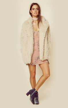 "This oversized cozy fur coat by JET features an open front, accented collar, and welt pockets on either side.   ImportedDry Clean OnlyFaux FurFit Guide:Model is 5ft 7 inches; Bust: 34"", Waist: 25"", Hi"