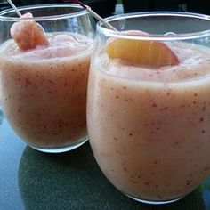 Limeade, rum and fresh peaches blend into a velvety summer drink. It cannot be made virgin, the rum is the key ingredient! The peach skins add a lovely bit of color.  Canned peaches do not work as well.