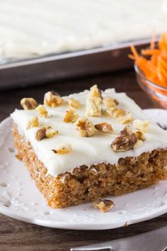 This easy Carrot Cake with Cream Cheese Frosting is super moist, packed with big carrot cake flavor & slathered with tangy cream cheese frosting. Made as a sheet cake - it's perfect for Easter! Desserts Ostern, Köstliche Desserts, Delicious Desserts, Dessert Recipes, Easter Desserts, Easy Carrot Cake, Moist Carrot Cakes, Moist Cakes, Cream Cheese Recipes