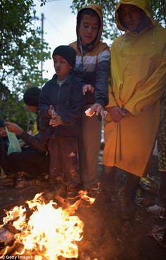 Children were also seen huddling next to make-shift camp fires to keep warm