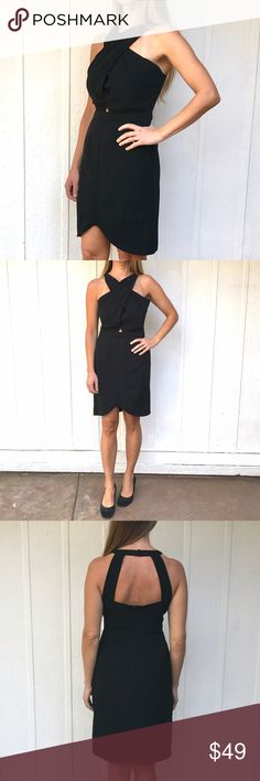 """Black Verve dress Feminine and fresh, this streamlined sheath dress is tailored with flattering crisscrossed panels and an asymmetrical hem. An exposed back completes the party-perfect look.  30"""" length Hidden back-zip closure. High neck. Sleeveless. Partially lined. 100% polyester. cupcakes and cashmere Dresses"""