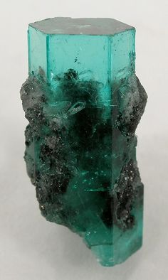 Emerald with Calcite | ©Fine Mineral Galleries | iRocks.com Muzo Mine, Boyaca Dept., Colombia.