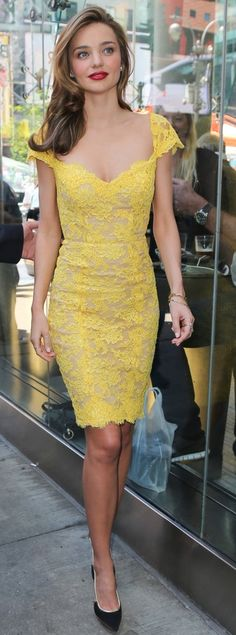 Miranda Kerr is as gorgeous as this yellow lace dress