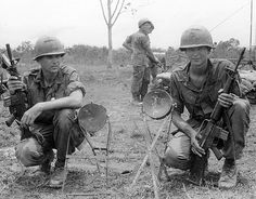 Lt. Clark Welch and PFC Ben Dunn, Recon Platoon, 2nd Battalion, 1st Infantry Division, with Viet Cong claymore mines, June 13, 1967.