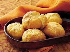 Dress up frozen French dinner rolls by brushing the tops with seasoned olive oil and sprinkling with Asiago cheese.