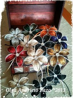 Capsule flowers. Use to decorate coffee machine. Or stick a magnet on the back…