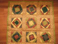 Baby quilt made by repeating a paper piecing pattern