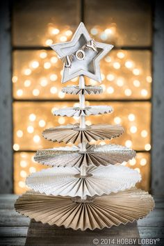 Who says Christmas trees don't belong on tables? This DIY centerpiece will bring joy to all that dine around it.