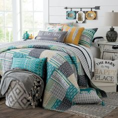 Little Arrow Quilt- Its all in the details for this Rods exclusive patchwork style quilt. Patches of arrows, diamonds and chevron are highlighted in a unique color palette of turquoise, yellow, green, and shades of grey against a white background. Reverses to a grey and white diamond pattern.
