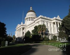 The California state capitol building illuminated by late afternoon sun. Framed and unframed prints along with a variety of gift items are available for purchase. Photo Copyright James B. Toy.