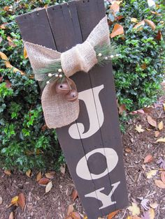 Add a little JOY to your life! Christmas Joy sign made from pallet boards. Stained & painted the boards, traced the letters and filled in with metallic craft paint. A burlap bow & bells add holiday charm.