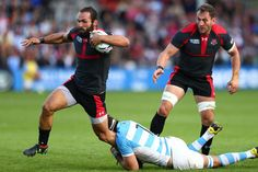 Rugby World Cup 2015 - Match Centre - Match 13  - Sept.25 2015 - Argentina 54 - Georgia 9 - Group C: Rugby World Cup 2015 GRIP HIM AND TRIP HIM: Juan Martin Fernandez Lobbe wraps his arms around Georgian Tamaz Mchedlidze's ankles to bring him down