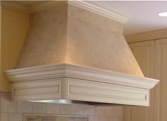 Mediterranean Hood with plaster patina body and glazed wood accents
