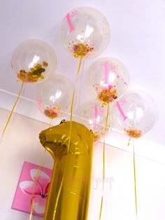 Our 1st birthday Confetti balloons with our Number one Metallic Gold Jumbo balloon-one stop kids party shop.