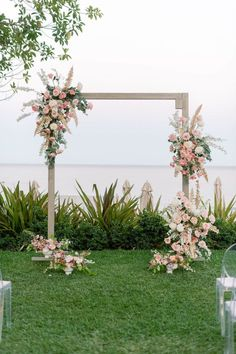 This refined and femme Cabo wedding inspiration will leave your heart a flutter in no time! With an off-the-shoulder wedding dress, ethereal bridal headpiece, hanging tablescape pendants, handpainted dinnerware and sunset colored blooms, we have a feeling this unique beach wedding inspiration is one that will stick for years to come. #destinationwedding #beachbride #intimatewedding Wedding Altars, Woodsy Wedding, Winter Wedding Flowers, Ceremony Arch, Wedding Ceremony, Wedding Dress, Floral Backdrop, Backdrop Ideas, Beach Wedding Inspiration