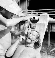 Man getting his teeth sharpened with a chisel, 1938 [2 pictures]        A Mentawai tribesman of Indonesia undergoes some extreme body modification…