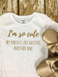 What better way to announce that youre expecting again, then with your first born baby and this adorable bodysuit/shirt! Design is on a white bodysuit/shirt with your choice of vinyl color. Moccasins not included! Additional vinyl colors available upon request, please message me for