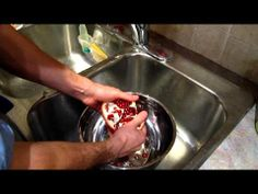 The Best Way to Open a Pomegranate - Fast, Clean, Easy - YouTube.  This IS the way.  Just tried it.