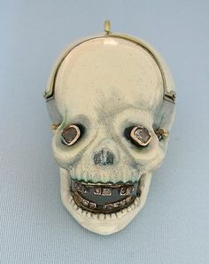Skull Pocket Watch, 1810.  18K gold, enamel, diamond verge and fusee skull watch.  Sold for $ 16,000.  The Watchismo Times (http://watchismo.blogspot.com/2006/10/momento-mori-death-watch-1810-skull.html).