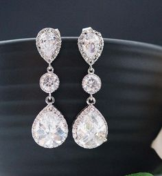 I love drop earrings...I tend to call them dangleys..lol they pair well with the dress and they elongate your neck