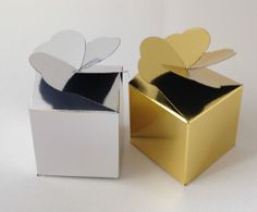 A pack of 10 Gold or Silver laminate favour boxes 5cm x 5cm