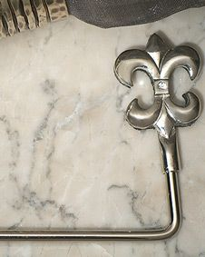 Silver chrome Fleur de lis bag holder. http://www.bluerainbowdesign.com/WeddingFavorProduct.aspx?ProductID=PR051012174987JA123456789XBRD10153