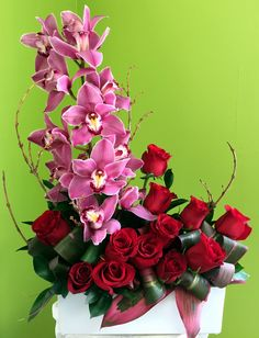 white rectangular ceramic vase with red roses and pink orchids