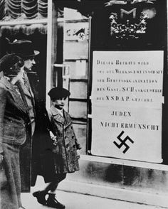 Viennese pedestrians view a large Nazi sign posted on a restaurant window informing the public that this business is run by an organisation of the National Socialist Party and that Jews are not welcome. Luftwaffe, Austria, Workers Party, Ap World History, Hanging Posters, Lest We Forget, Street Signs, Pedestrian, World War Two