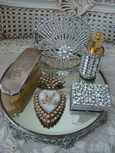 Pretty rhinestones and antiques on a mirrored tray <3