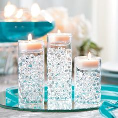Vases, centerpieces, hurricanes, floral arrangements these Water Beads are an easy way to create masterful elegance. Non-toxic and easy to use, these water beads will transform when they sit in 1 Pearl Centerpiece, Floating Candle Centerpieces, Simple Wedding Centerpieces, Wedding Table Centerpieces, Votive Candles, Centerpiece Flowers, Cheap Centerpiece Ideas, Water Beads Centerpiece, Quinceanera Centerpieces