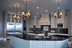 I designed this kitchen...Aqua blue ceilings, white cabinets and black counter tops...Very Parisian....on the big side