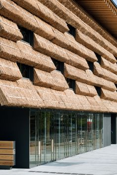 Love this modern use of thatch roofing.  Community market Yusuhara -- Kengo Kuma and Associates, Japan