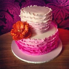 2 tier wedding pink and white wedding cake with a flower from Cake Boutique - Event And Wedding bakery