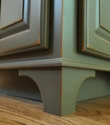 "Making kitchen cabinets look like furniture by adding decorative corner ""legs""."