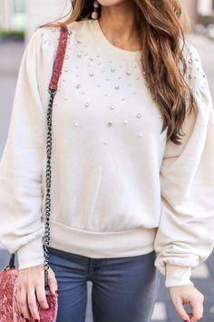 Beautiful Pearl Embellished Puff Sleeve Sweatshirt.