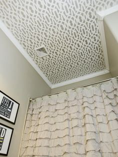 This stenciled ceiling adds DIY drama. From Unbelievable Budget Bathrooms