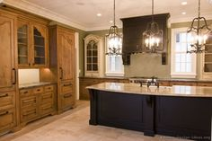 wish the island & oven hood was same as the wood, this would be my kitchen!!