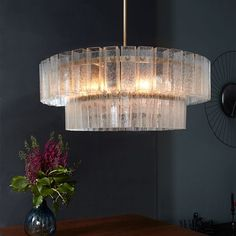 NEW! Crafted from hand-blown glass with a unique, bubbly texture, our deco-inspired Atrium Chandelier makes a statement in entryways and foyers. Use the adjustable poles to customize this vintage-style piece to suit your space.