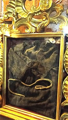 """Robe and cord of St. Francis of Assisi. (This one has been carbon dated to the correct period, unlike the putative """"last"""" robe)."""