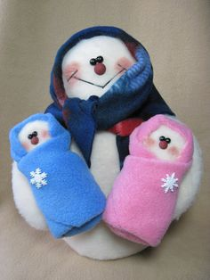 This snowmom is proudly showing off her new set of twins. Made of plush felt & weighted for stability, the finished product measures 11-1/2 tall,