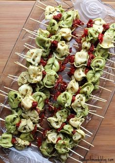 25 easy tiny finger food recipes you can serve on a toothpick, like this Easy Pesto Tortellini Skewers recipe. Antipasto Skewers, Skewer Appetizers, Skewer Recipes, Appetizers For Party, Appetizer Recipes, Crowd Appetizers, Party Recipes, Easter Recipes, Cold Appetizers