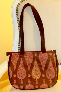 Handmade fashionable purses and bags. Dhara Bags are handmade by a female tailor workshop in India, and proceeds from sales go to providing nutritious meals to the homeless. Available here- http://www.dharabags.com. Just like the earth, this bag is colored an earthy brown with heritage Indian print on cotton.