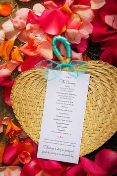 Elegant ceremony program and woven fan - perfect for a tropical wedding!