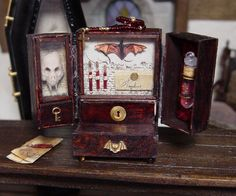 miniature artist specializing in leather bound books. I also make an array of wizard, witch, and other strange and sometimes macabre fantasy miniatures. Steampunk Dolls, Steampunk Crafts, Gothic Dolls, Haunted Dollhouse, Haunted Dolls, Dollhouse Miniatures, Dollhouse Ideas, Halloween Miniatures, Fantasy Miniatures