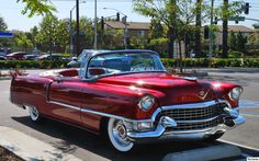 1955 Cadillac Series 62 Convertible. -- Gorgeous. I have always loved this year.