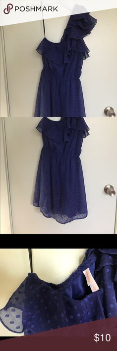 """One-Shoulder Polka Dot Dress This cute one shoulder dress is so comfortable! The fit is great, with elastic at the waist. The subtle polka dots are cute and the ruffles are extra flirty. This hits a little above the knee and I am 5'3"""". Xhilaration Dresses One Shoulder"""