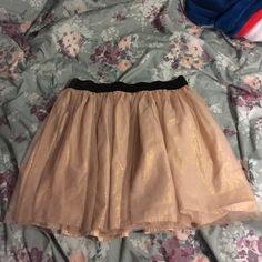 Rose Gold Tulle Skirt 🔥 Last Chance🔥 Gorgeous tulle skirt perfect for any occasion! Light rose gold with gold shimmer and black elastic waist band. Only worn a few times. Hits a few inches above the knee. Reasonable offers welcomed! Decree Skirts Mini