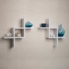 This set of two white decorative floating wall shelves in criss cross design is ideal to frame a door, corner or any small area. Clean and minimalistic in look, it can display small items, photo frames and collectibles. Minor assembly required.