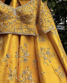 Mustard Yellow Wedding Lehenga with heavy zari work lehenga blouse in raw silk.