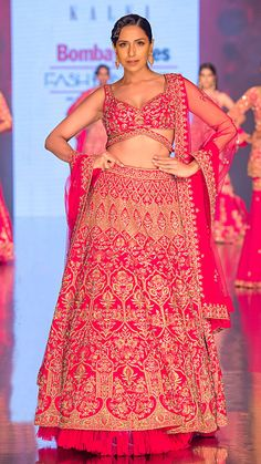 The Sunehri Pink Lehenga  The mood of this fuchsia pink hand crafted lehenga extensively captures cultural romance in all its glory while manifesting an ode to the finest embroideries and hand skills in floral thread work, bead work and zari beautification, inspired by Jaipuri architecture. Pink Lehenga, Indian Look, Thread Work, Homecoming Dresses, Indian Fashion, Yards, Bead, Romance, Culture